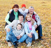 Family with grandparents in autumn park Royalty Free Stock Photo