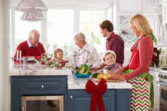 Family With Grandparents Preparing Christmas Meal In Kitchen Stock Photography