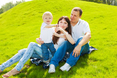 Family on grass Royalty Free Stock Photos