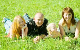 Family on grass Stock Photo