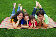 Family on the grass royalty free stock photo