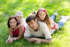 Family on grass Royalty Free Stock Image