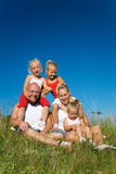 Family in the grass Royalty Free Stock Photos