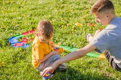 Family grass boy brother park. happy summer stock image