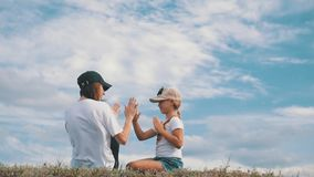 Family on grass with hands up and dream. Happy family concept, lifestyle, freedom. Family on grass with hands up and dream. Happy family concept, lifestyle stock video footage