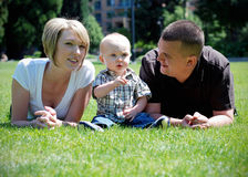 Family in Grass - horizontal Royalty Free Stock Photography