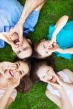 Family on grass shouting Stock Photo