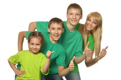 Family in a green clothes Stock Images
