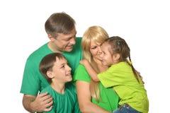 Family in a green clothes Stock Photos