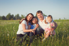 Family in the green field Stock Photos