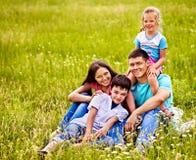 Family on green grass. Royalty Free Stock Photos