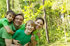 Family in the green jersey Royalty Free Stock Photos