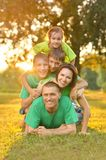 Family in green jersey Royalty Free Stock Image