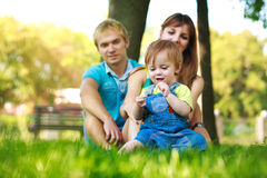 Family on a green lawn in park Stock Image