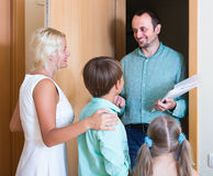 Family greeting guest at the door Royalty Free Stock Image