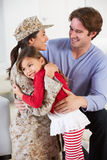 Family Greeting Military Mother Home On Leave. Family Hugging And Greeting Military Mother Home On Leave Royalty Free Stock Photos