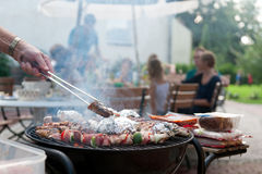 Family grilling. In the garden Royalty Free Stock Photography