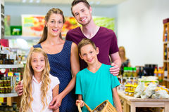 Family grocery shopping in corner shop Stock Photos