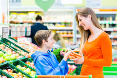 Family grocery shopping in hypermarket Royalty Free Stock Photography