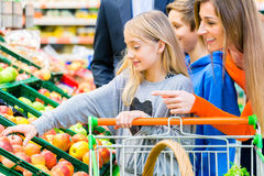 Family grocery shopping in hypermarket Stock Image