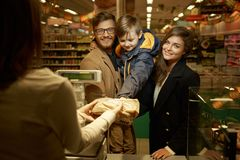 Family in a grocery store Royalty Free Stock Photo