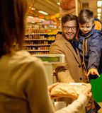 Family in a grocery store Royalty Free Stock Images