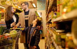 Family in a grocery store Stock Photos