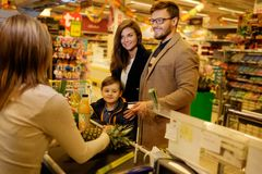 Family in a grocery store Royalty Free Stock Photography