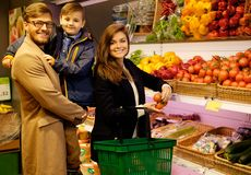 Family in a grocery store Royalty Free Stock Image