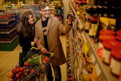 Family in a grocery store Stock Photo