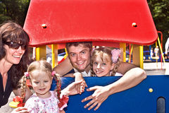 Family and group children in playground. Royalty Free Stock Photo