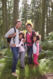 Family Group Hiking In Woods Together Stock Images