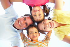 Family Group Looking Down Into Camera. Smiling stock photography