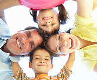 Family Group Looking Down Into Camera. Smiling Royalty Free Stock Photography