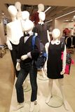 Family group of multiple mannequins include adult children white heads royalty free stock photo