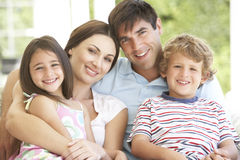 Family Group Relaxing On Chair Together stock photo