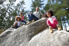 Family Group Sitting On Rock Together Stock Images