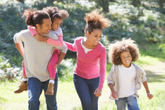 Family Group Walking In Countryside stock photo