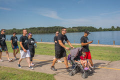 Family groups with kids walking the 5K. Family walking for the Free to breathe 5K walkathon for lung cancer royalty free stock image