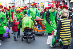 Family Groups walking in carnival parade Royalty Free Stock Photography