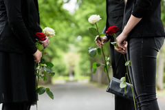 Family in guard of honor at funeral. Only torso of people to be seen stock photo