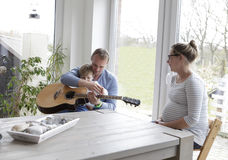 Family with guitar Stock Photo