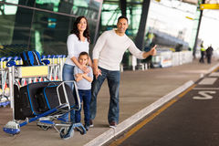 Family hailing taxi Royalty Free Stock Image