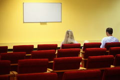 Family in hall is waiting start of showtime Stock Image