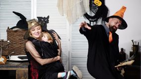 Family in halloween costumes. Happy family mother father and childboy in costumes on a celebration of Halloween. Happy stock video