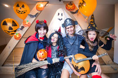 Family in halloween costumes. Family in costumes has fun in her house in halloween royalty free stock photo