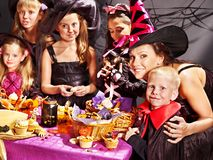 Family on Halloween party with children. Royalty Free Stock Image
