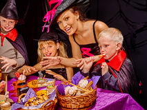 Family on Halloween party with children Royalty Free Stock Photos
