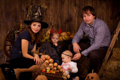 Family on Halloween party with children Stock Photography