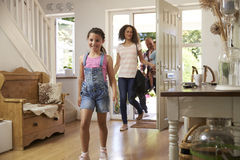 Family In Hallway Returning Home Together Stock Photography